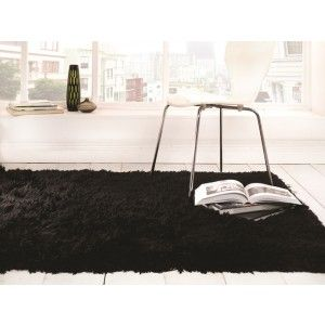 Black Luxury Sheepskin Rug made with 100% polyester. The rug has a 8.1cm pile and therefore has a super soft feeling. http://www.therughouse.co.uk/sheepskin-rugs