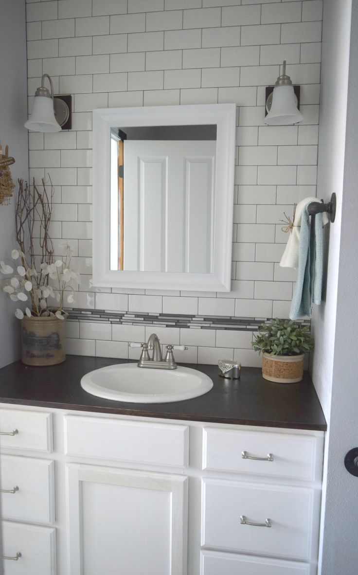 The Awesome Web bathroom redo ideas Low cost ways to renovate using subway tiles and painting cabinet