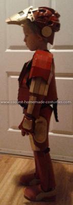 Coolest Homemade Child's Iron Man Costume - Side View: Homemade Child's Iron Man Costume:  Materials - Cardboard, Foam sheets, Paint (Maroon/Gold), Hot Glue, Sweat pants, Hooded Sweat Shirt, Push Light, Tea