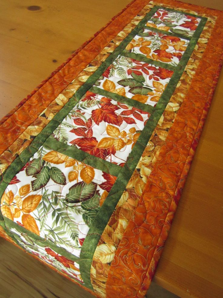 Quilted Table Runner Handmade Leaves could be a quilt as you go using large squares and strips first then adding the borders.  Great look for fall or any season