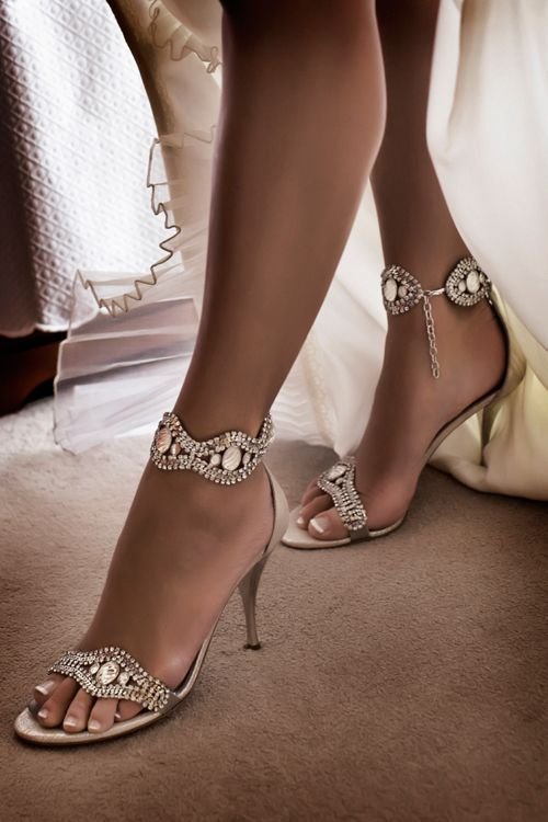 Crystal shoes add some flash to the bride.  If you love shoes and are looking for wedding shoes enjoy and repin this.