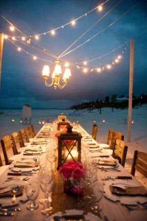 Table scape + lights for a night party on the beach.