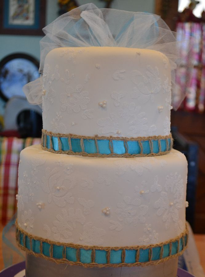 Lace stencil wedding cake for the top of a cupcake tower