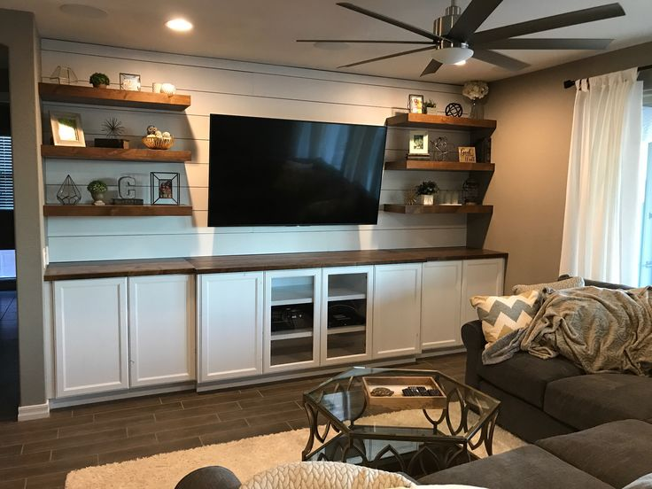 This is becoming a popular layout for our built in entertainment centers. Who doesn't want shiplap and floating shelves?