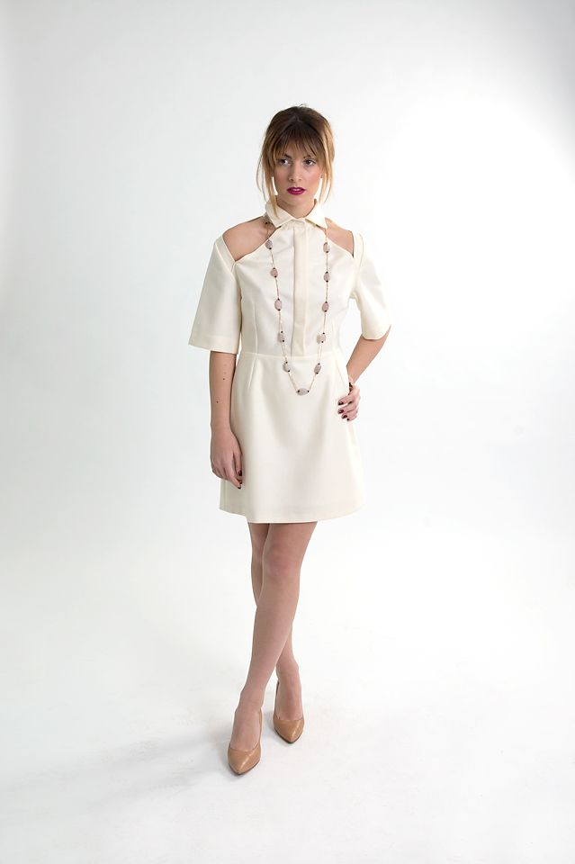 White linen short dress with cut-outs.