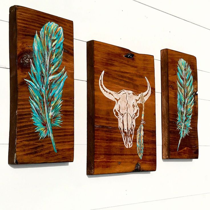 NEW Vibrant Native American Decor!!! This trio has slightly textured feathers and a distressed bull skull with feather tassel.