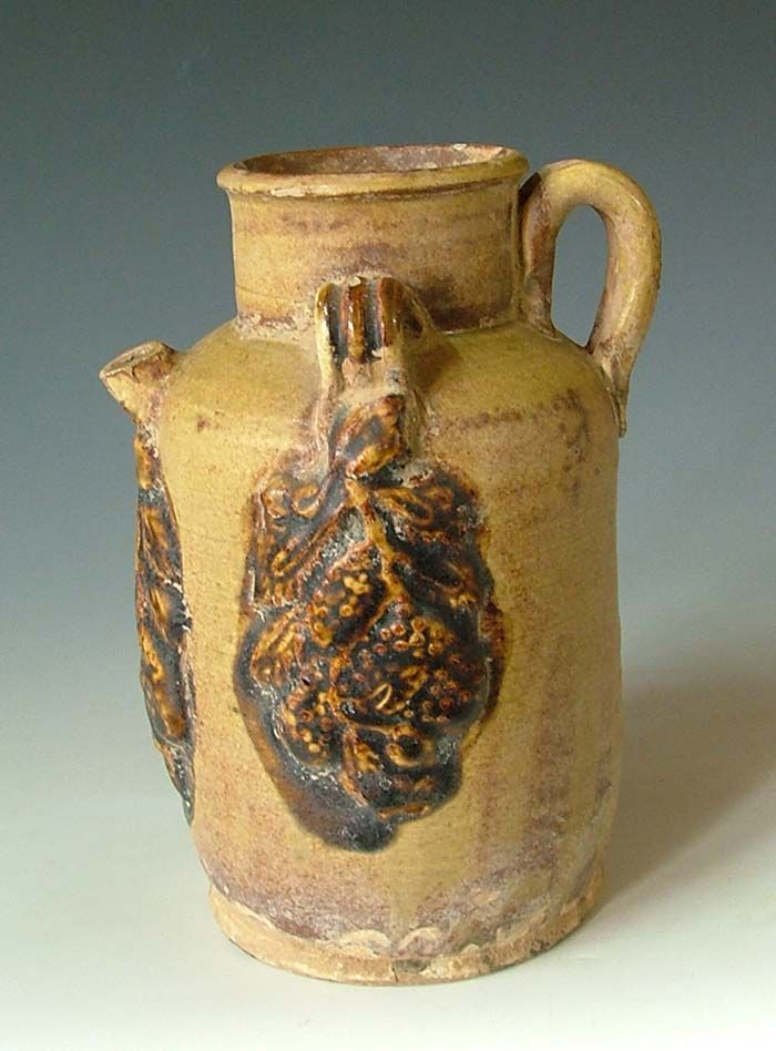 Tang Dynasty Changsha Kiln yellow glaze pottery vine pot with molded applique design.
