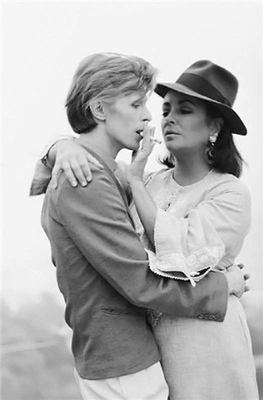 Love this 1975 photo of David Bowie and Liz Taylor by Terry O'Neill.