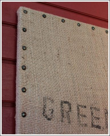 Cheap wall decor ideas that don't LOOK cheap! burlap coffee bag stretched over canvas - decorative nail heads added to the edges.