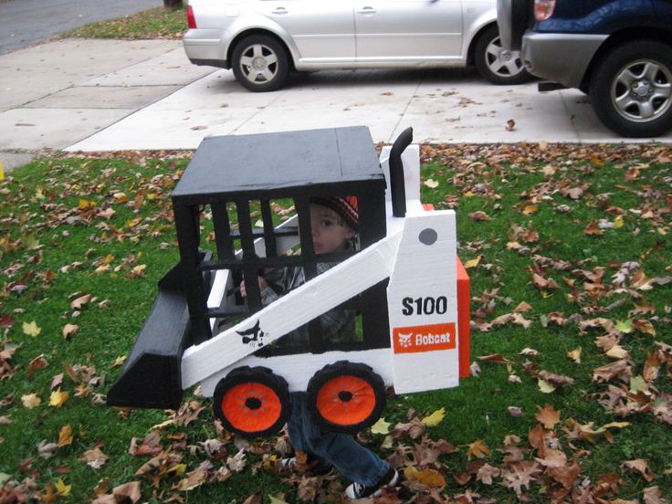 Wearable Bobcat skid steer costume with LED headlights and taillights