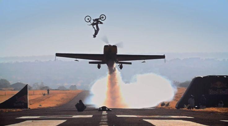 Dirtbiker casually backflips over plane