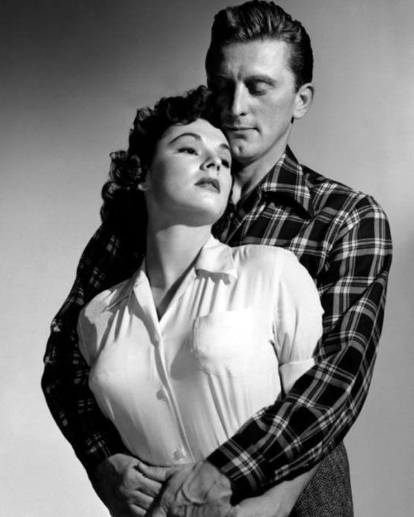 RUTH ROMAN AND KIRK DOUGLAS IN CHAMPION