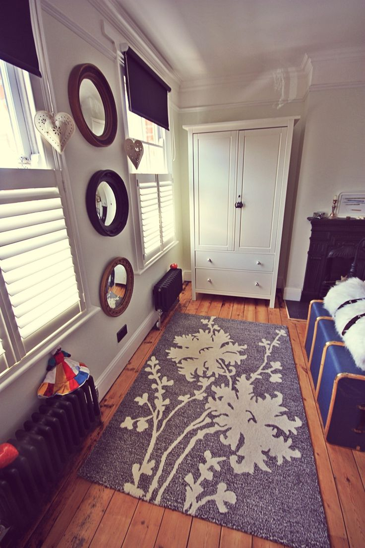 Main Bedroom, Vintage concave mirror, Victorian style cast iron radiators, Bentwood steamer trunk, Plantation shutter blinds, Victorian House, Renovation.