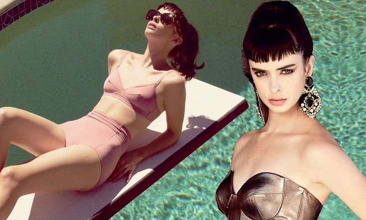 Krysten Ritter reveals her toned tummy as she lounges around poolside in retro bikini