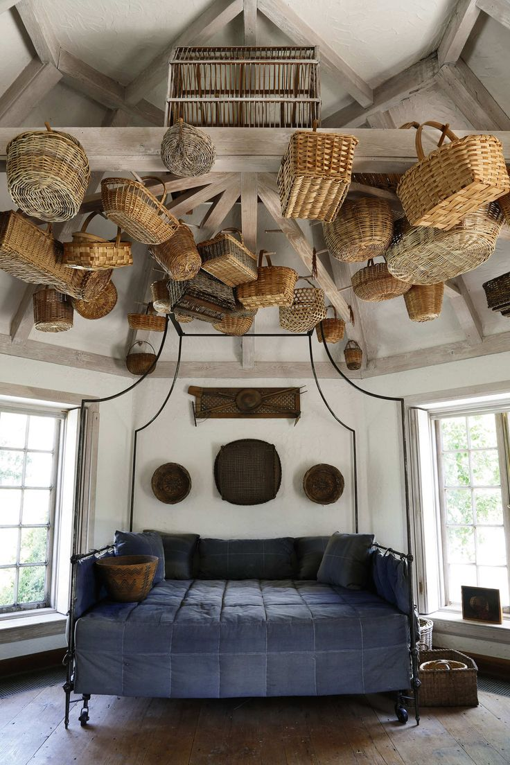 Single-object decorating is always effective, especially in Mrs. Mellon's houses. A French steel-campaign tester bed, shown here with baskets hanging from the ceiling, was in Oak Spring Farm, and is for sale. Photo: Courtesy of Sotheby's