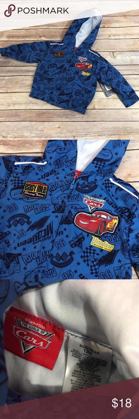 """Cars Disney Lightning McQueen Windbreaker Jacket Cars Disney Lightning McQueen Windbreaker Jacket NEW NWT 12 mo  Was part of a 2 pc set but I never had the second piece. Super cute with Cars patches and graphics.  Elastic at waist and cuffs. Zip Front Lined 100% polyester 12.25"""" long 12.25"""" p to p Disney Jackets & Coats"""