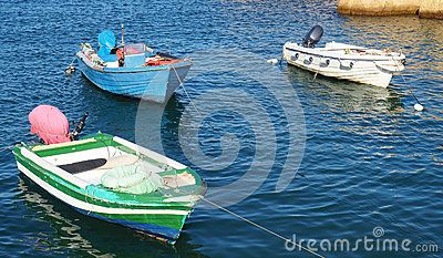 Boats are anchored in the harbour near the Fortaleza de Ponta de la Bandeira, constructed in the late 1600's in Lagos, Portugal.