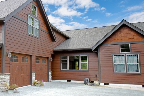 Beautiful RusticSeries lap siding on single family home. Warm Espresso lap siding with Old Cherry Shake Panels. Traditional natural looking home.