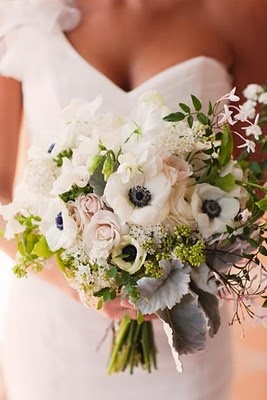 This beautiful bouquet just ties everything together perfectly.  The natural greens along with some peachy/pink and the deep blue/black of the white flowers would go so beautifully with the wedding and bridesmaid dresses.  #acitywedding