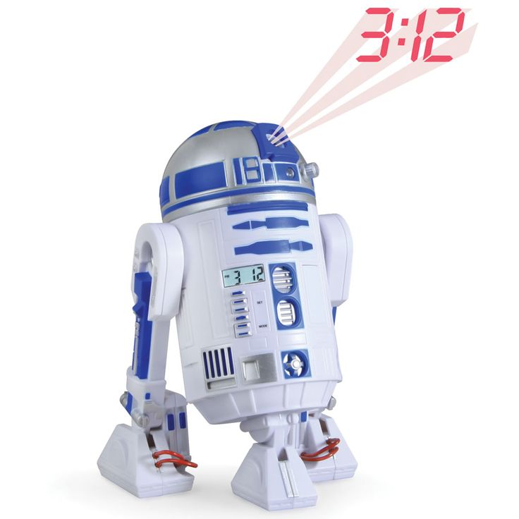 The R2-D2 Projection Alarm Clock - Hammacher Schlemmer - When the alarm goes off in a darkened bedroom, the headstrong astromech droid projects the time onto a wall or ceiling and sounds a 30-second soliloquy of familiar whistles and chirps with the intensity and volume of a pending stormtrooper arrival.