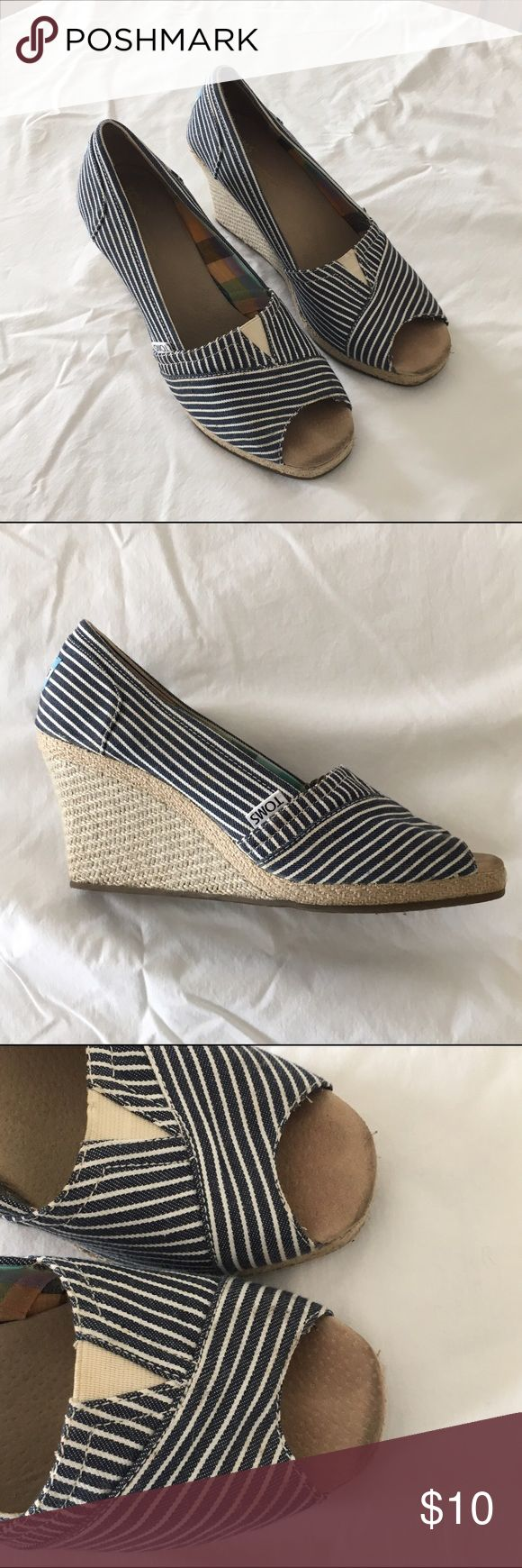 TOMS striped wedges Navy and tan striped canvas wedges with woven straw detailing. Slight scuffing on edge of toes shown in pic. Used condition. TOMS Shoes Wedges
