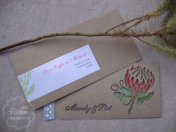 Laser cut protea invitation with addressed envelope from Ribbon Wedding Stationery, Johannesburg. http://www.ribbonweddings.com