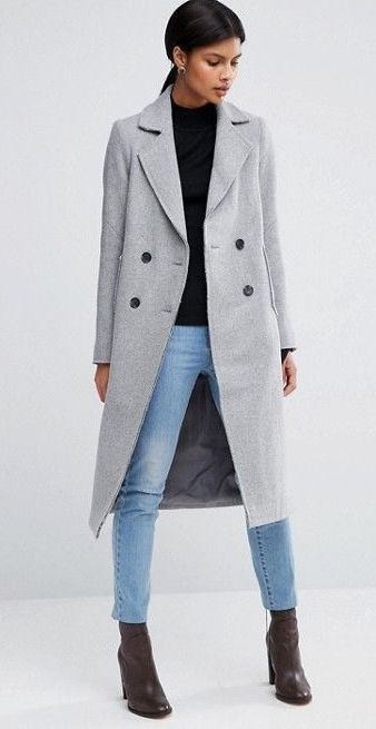 ASOS provides simplicity in this coat which is both elegant and right on trend. Its buttons down its double-breasted front add a stylish contrasting element. The raw edge detailing adds another subtle element of interest to the coat as do its functional pockets. A good blend of wool and polyester will keep you warm this season, and for years to come.