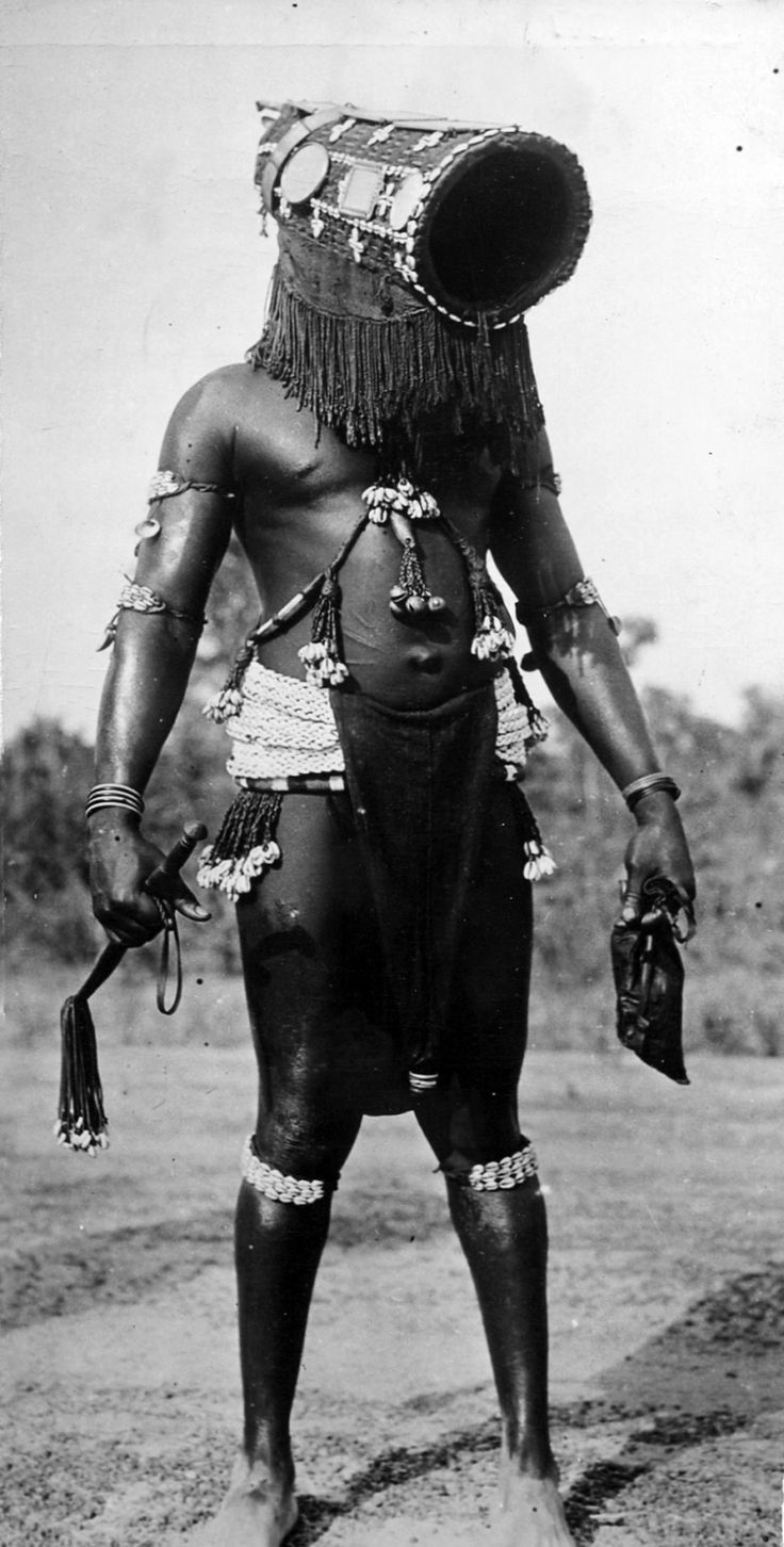 Africa | Dancer in traditional costume during a Presidential visit.  Ivory Coast.  ca. 1947 || Scanned vintage print.