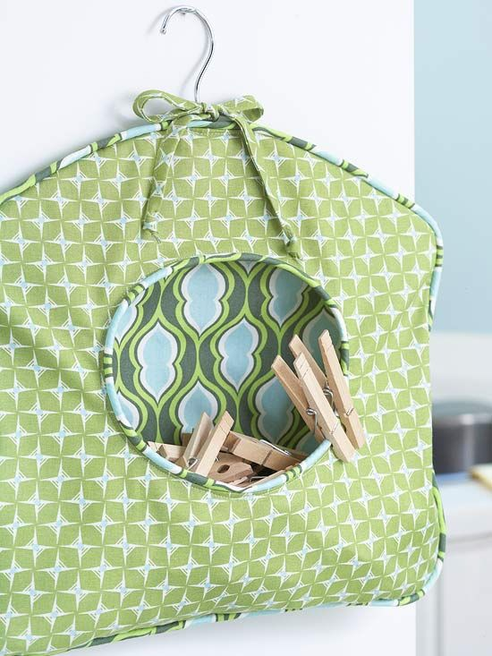 DIY Clothespin Caddy  This DIY clothespin caddy coordinates with the room's palette and provides a handy place to stash laundry accessories.  Click here to learn more about this project.