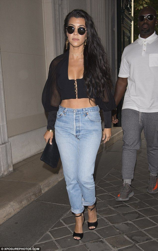 Toned physique: Kourtney was impeccably dressed in an off-duty outfit comprising a tiny, stomach-baring bralet