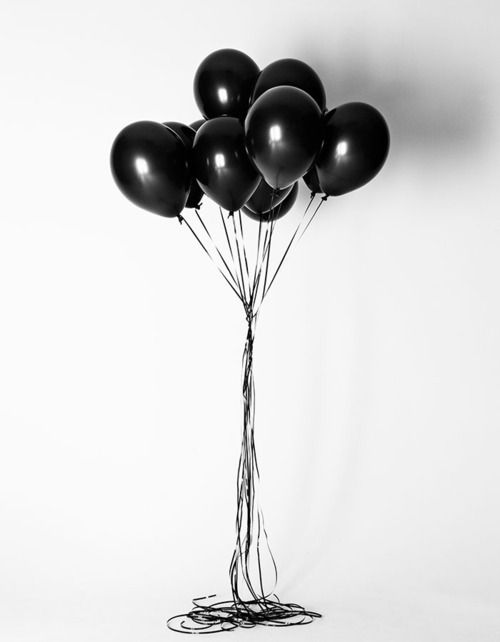 Black balloons on white