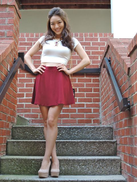 Blogger Kim in a Deb Shops crop top and nude pumps!
