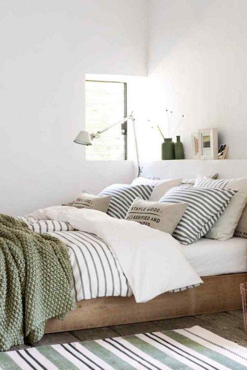 Tolle Farben im Schlafzimmer: Grün mit Holztönen.