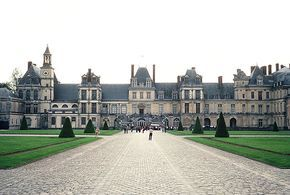 Chateau de Fontainebleau's entrance and façade. The actual palace was begun by Francis 1 drawn by the abundant game, which thrived in the vast forest. From the days of the Capetian kings to the time of Napoleon III, the Palace of Fontainebleau has been lived in, added to, and altered by the sovereigns of France. Napoleon Bonaparte preferred this to Versailles, because he was free of the overwhelming presence of Louis IV, his most formidable predecessor.