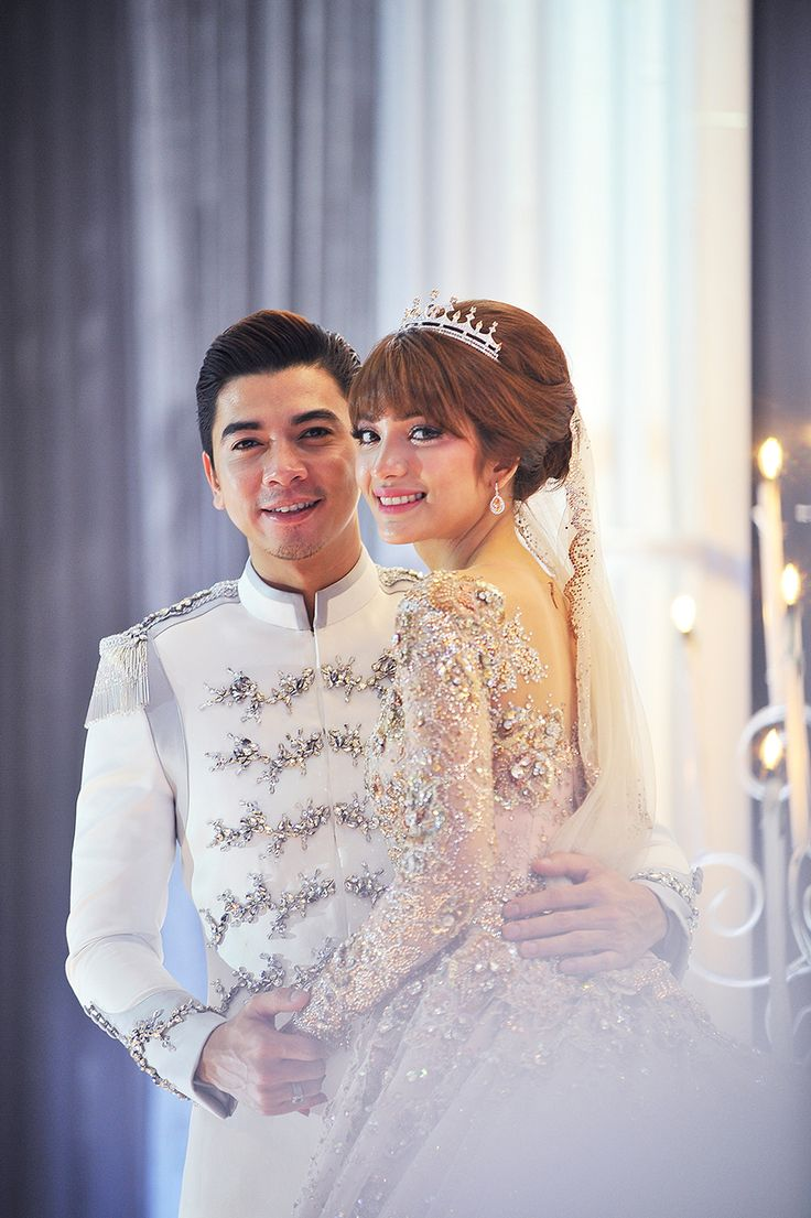 The Princely groom and his darling Princess bride in gorgeous matching sparkly outfits of white and pink // Malaysian TV personalities Amar Baharin and Amyra Rosli tied the knot in a lavish nikah (solemnisation ceremony) in Kuala Lumpur, Malaysia. The bride wore a jaw-dropping bespoke blush ball gown made of French lace and Swarovski crystals, while the groom looked every part the knight in shining armour in his Prince Charming-inspired suit by Rizman Ruzaini Creations. Here, we take you…