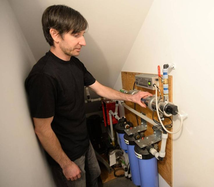 Don Welch, owner of Bundle Design Studio, shows off the water filtration system for in his energy-efficient house in Bellingham, Thursday Feb. 11, 2016. Water is collected off the roof of the house and stored in two 5,000 gallon tanks The house is not connected to the city water system.