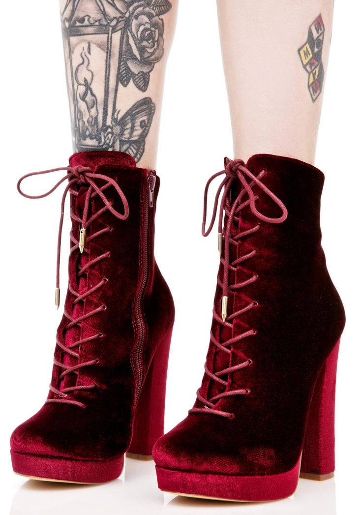 Wine Alea Lace-Up Boots are gunna step into the room and stop everything, babe. These sikk boots feature a mega plush dark red velvet construction, tapered toe, sky-high block heel, gold tipped lace-ups, and inner ankle zip closure for a sleek look.