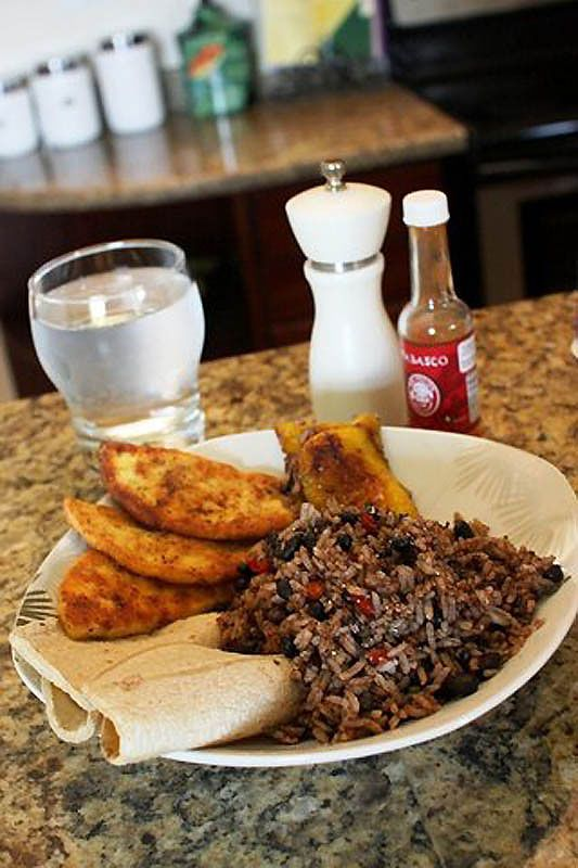 "Both Nicaragua & Costa Rica claim ""gallo pinto"" as their own. The combination of black beans, rice, & salsa over a corn tortilla is eaten at any time of day."