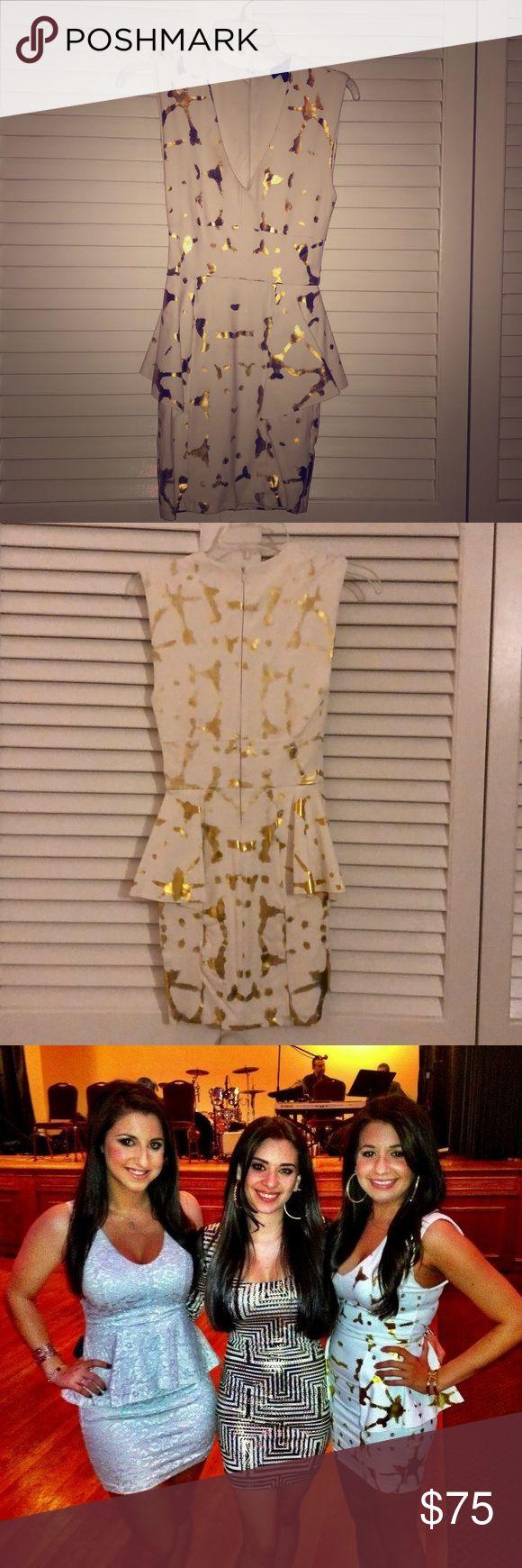 Bebe- White and Gold Peplum Dress Worn once. V-neck white peplum dress with gold splatter details. Size XS bebe Dresses Mini
