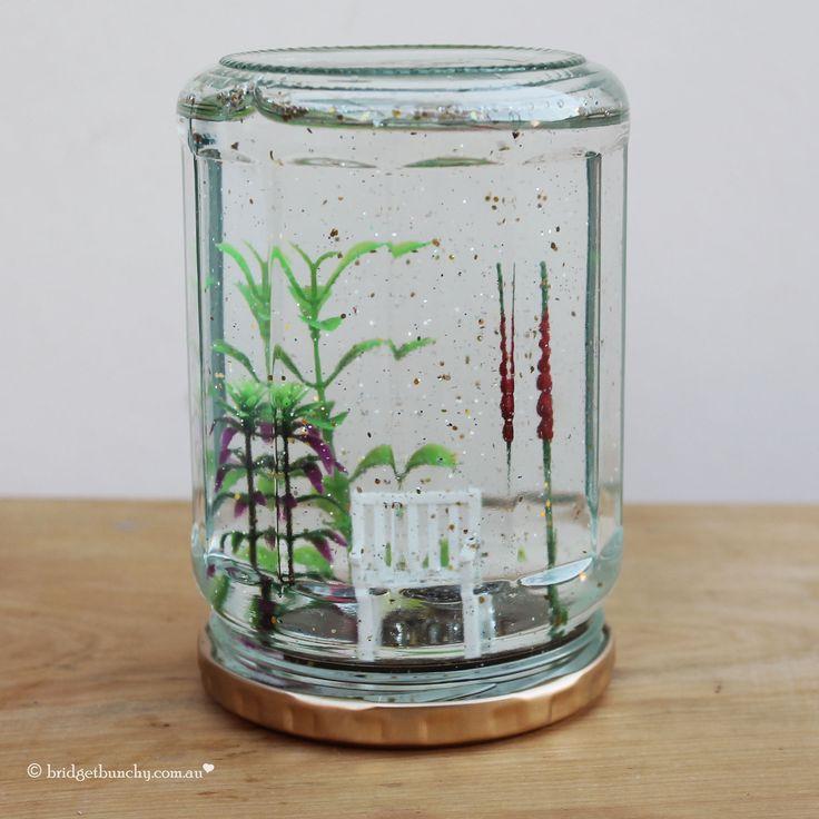DIY Snow Globe using a recycled jar. A beautiful glitter filled world.
