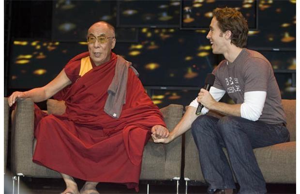 The Dalai Lama and child-rights activist Craig Kielburger talk at the We Day forum.