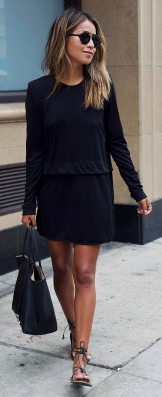 Julie Sarinana is killing the black outfit trend in this cute dress and sandal combo.   Dress: Sincerely Jules, Sandals: Madewell