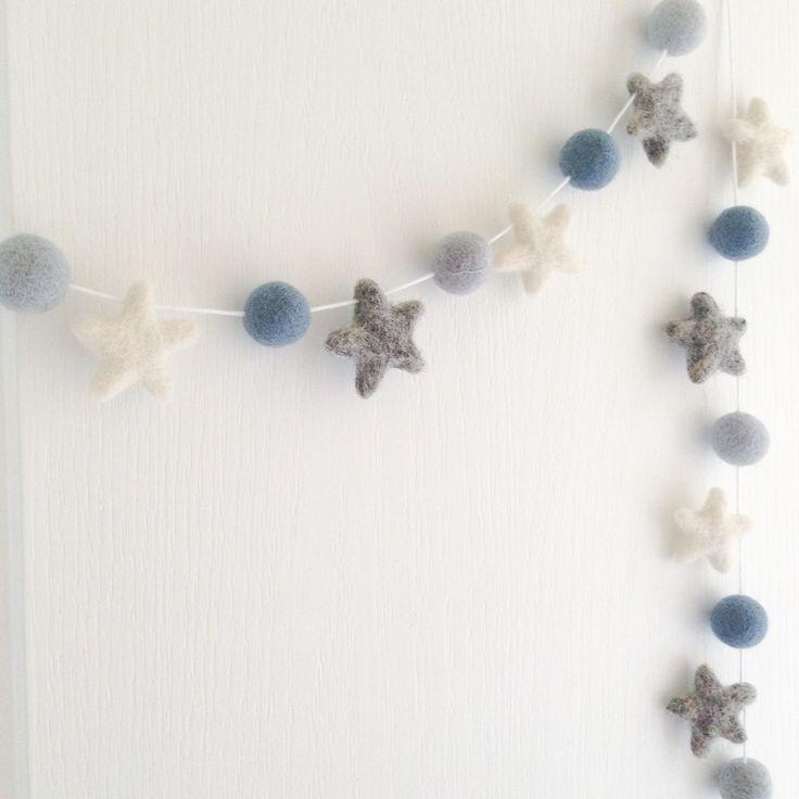 beautiful star felt ball garland from Stone and Co nursery decoration.