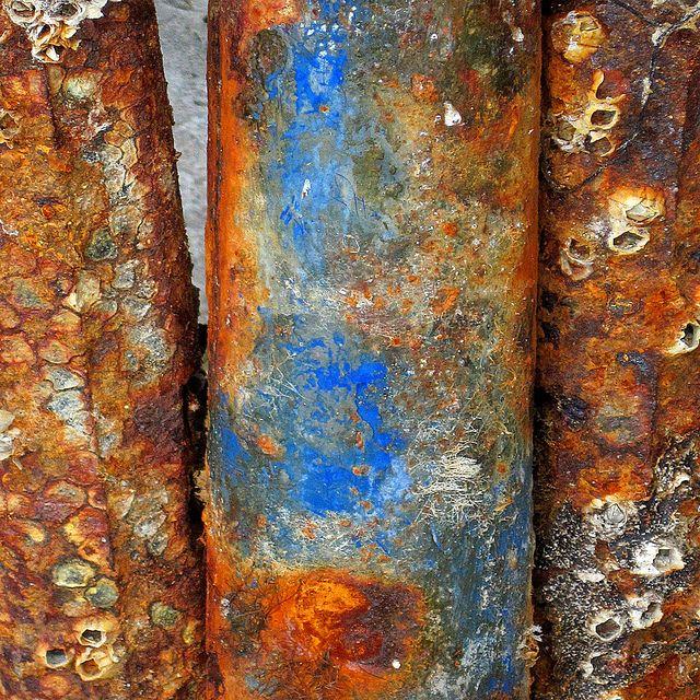 rust, peeling paint, barnacles.
