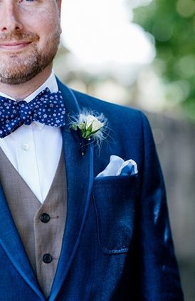 Navy velvet jacket and that bow tie! Literally the most unique groom's style ever!