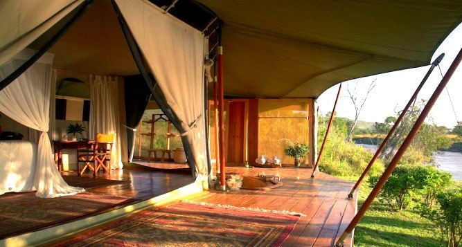 Ngare Serian, Masai Mara - KENYA. The exclusive Ngare Serian can only be accessed by swing bridge, and consists of four luxury marquees on hardwood decks elevated above the river.