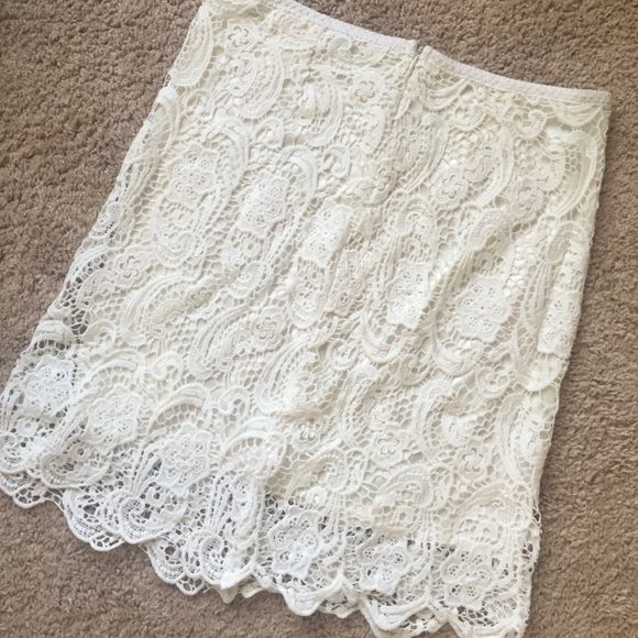 Cream lace skirt Beautiful cream lace skirt with side zipper. Silk slip attached underneath. Size M Skirts Pencil