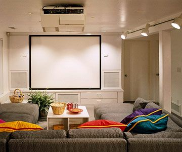 See the Big Picture. We always have movie nights! This looks so much fun! I love the colored pillows! I can just see a popcorn & cotton candy stand off to the side or behind! This is such a fab idea!