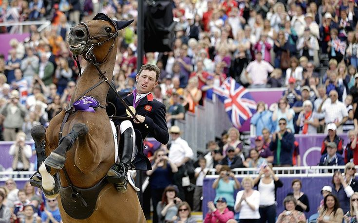 Hello Sanctos, the horse ridden by Scott Brash, of Great Britain, reacts as the crowd cheers during a victory lap after Great Britain won the gold medal for the equestrian team show jumping at the 2012 Summer Olympics
