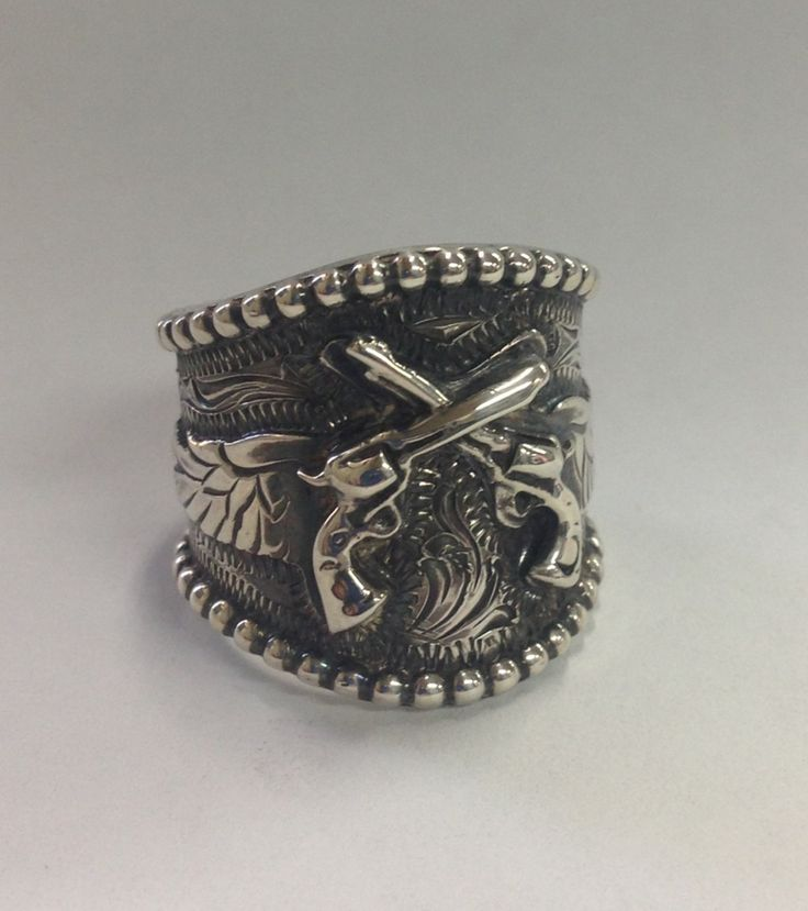Sterling crossed pistols and wings | Rings I like | Pinterest